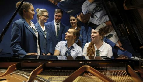 Music teacher with students