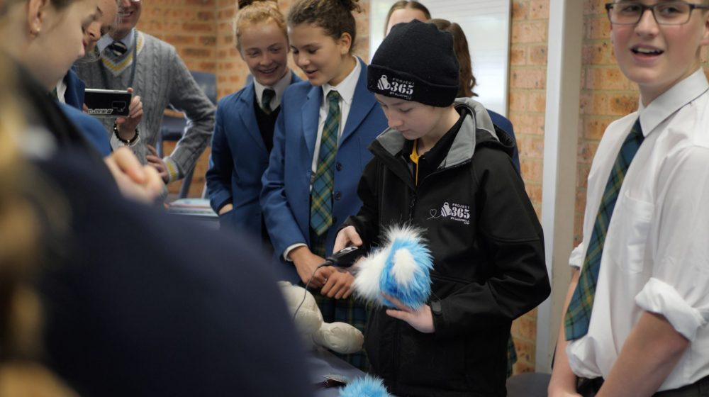 Campbell Remess working with HVGS students