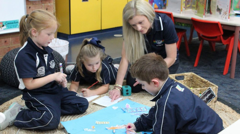 kindy students playing games