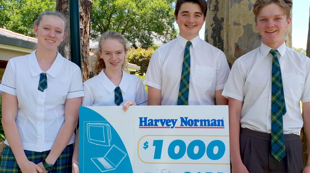 Students with giant cheque