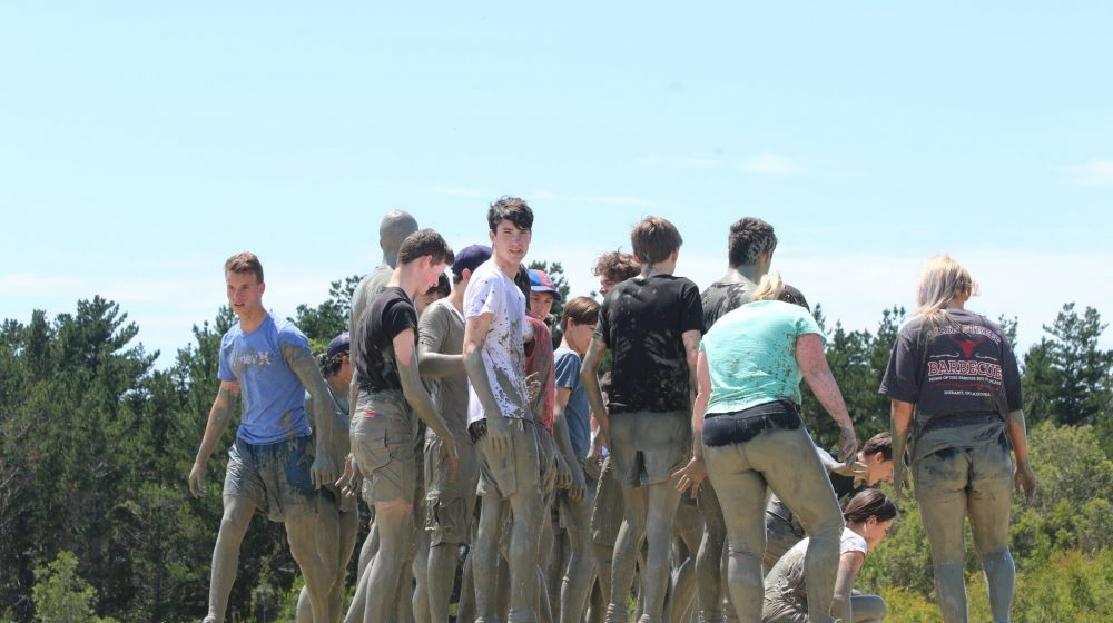 students in mud