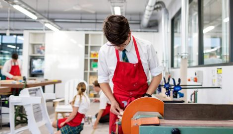 Male student on woodwork class