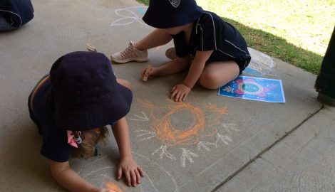 Children creating chalk art