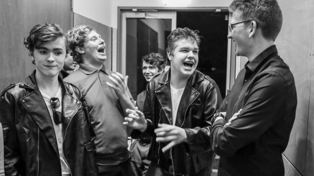 students backstage at musical show