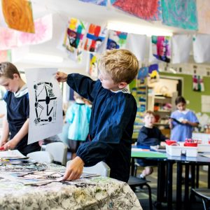 student looking at art