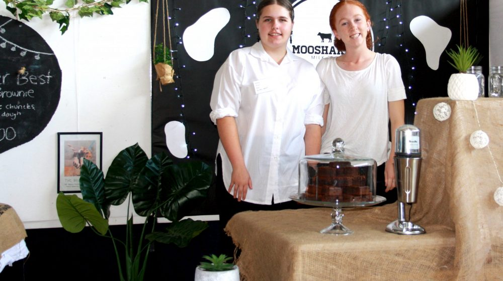 Two students at their display for Australian Business Week