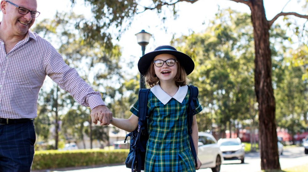 Student and parent walking