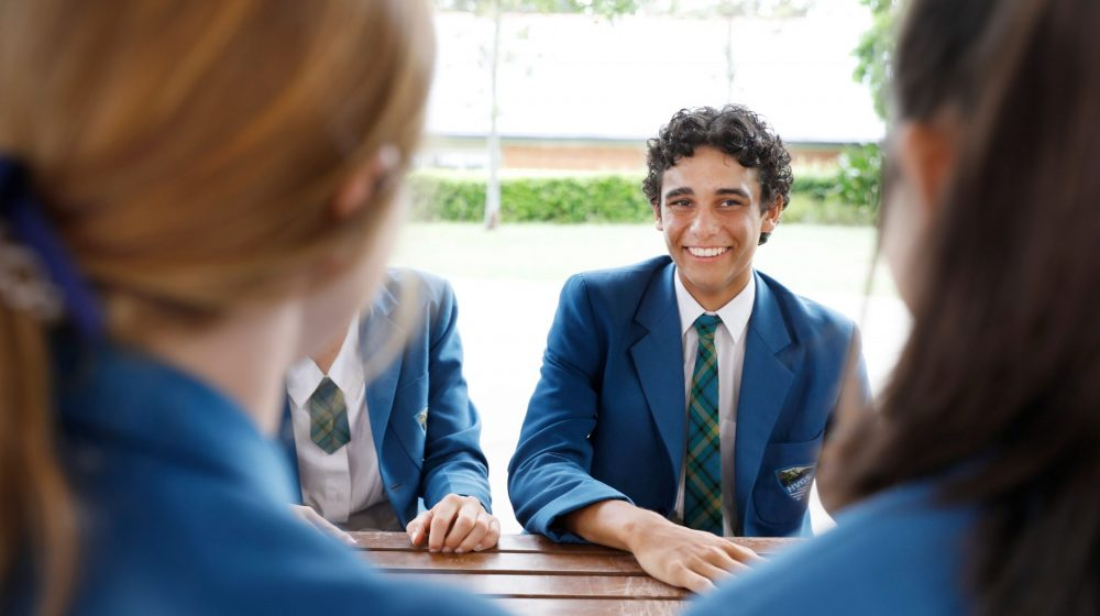 students chatting to other students