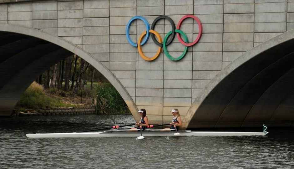 Rowers in river