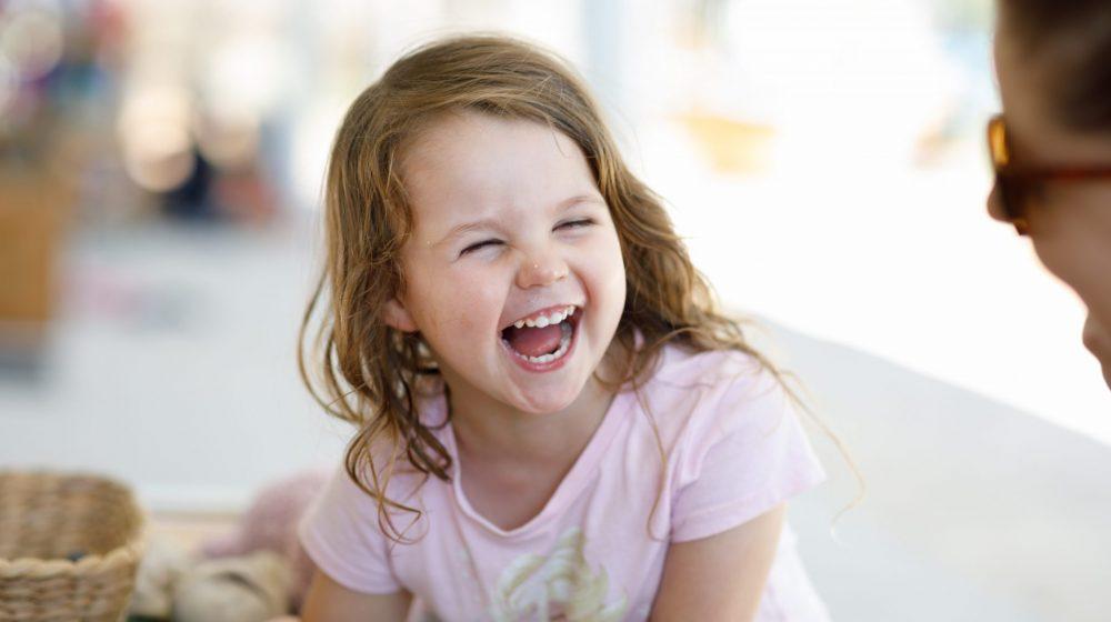 Preschool child laughing