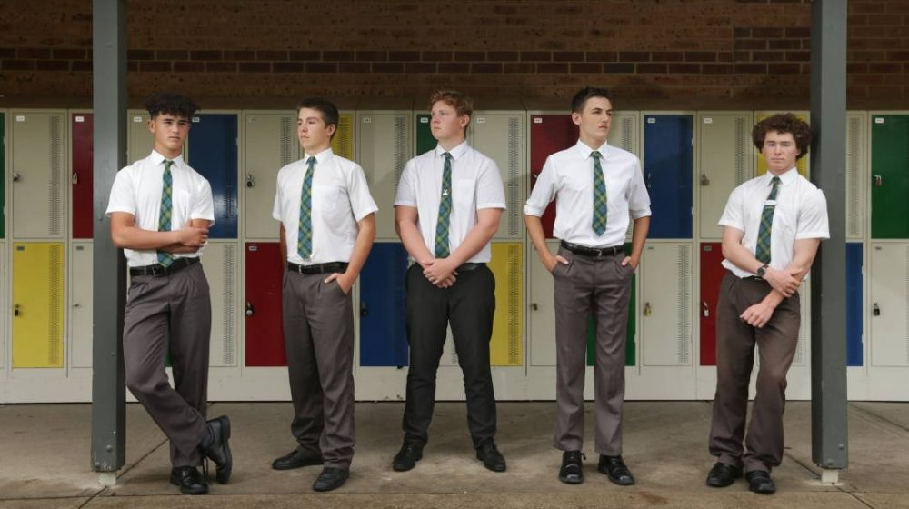 Boys standing near lockers