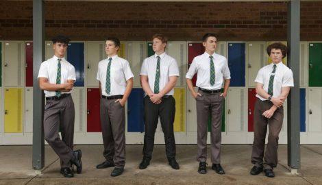 Boys standing near lockers