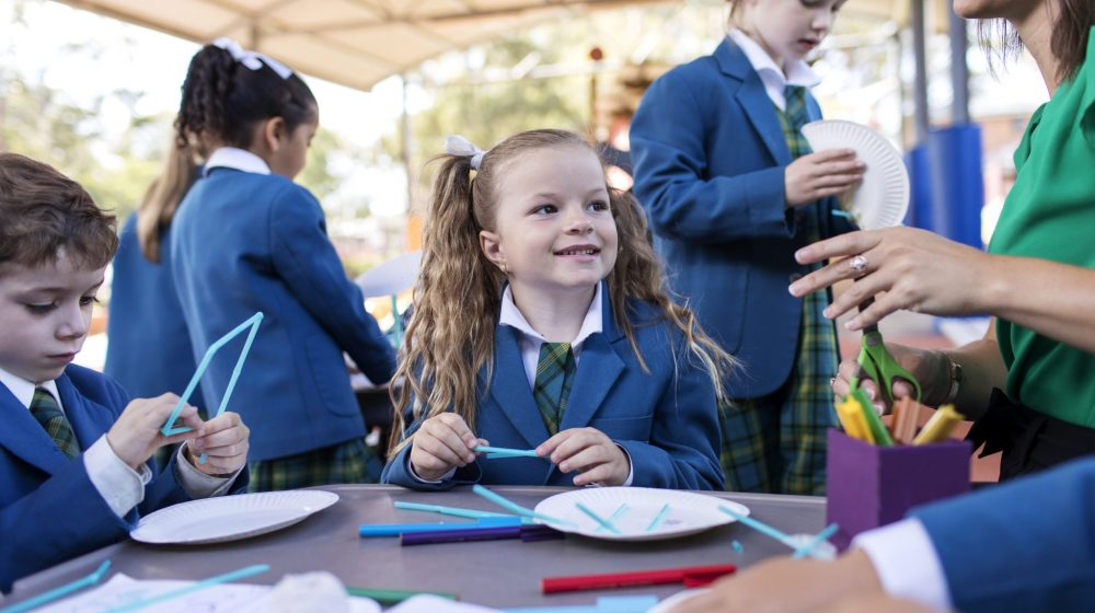 Kindy child smiling at friend