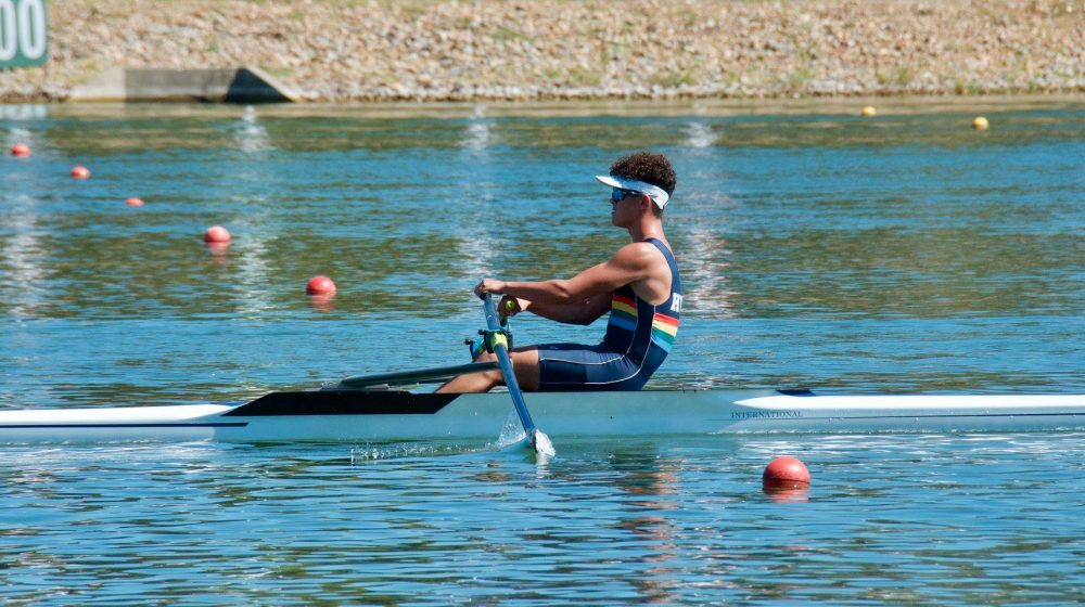male student rowing