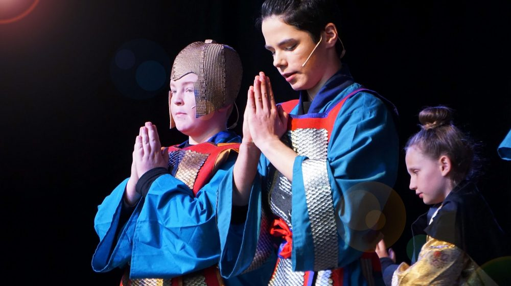 Two students performing in Mulan