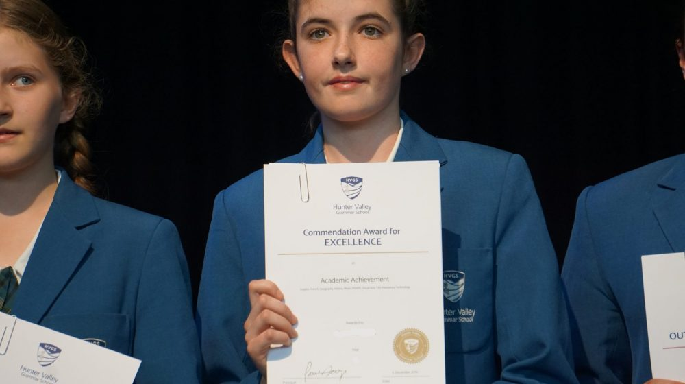 student holding certificate