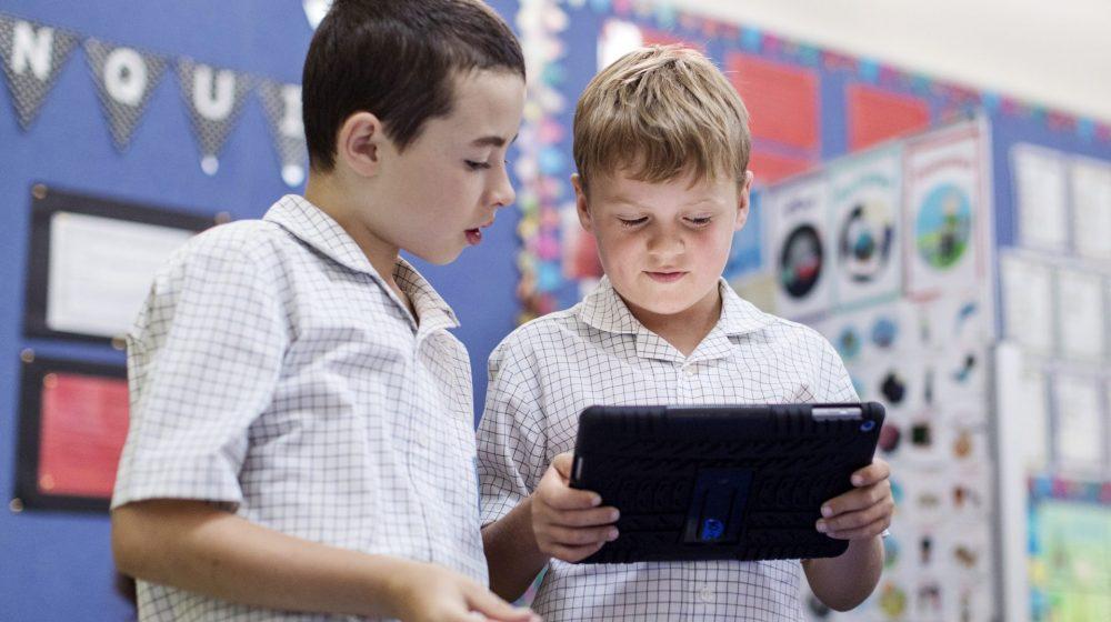 Students looking at iPad