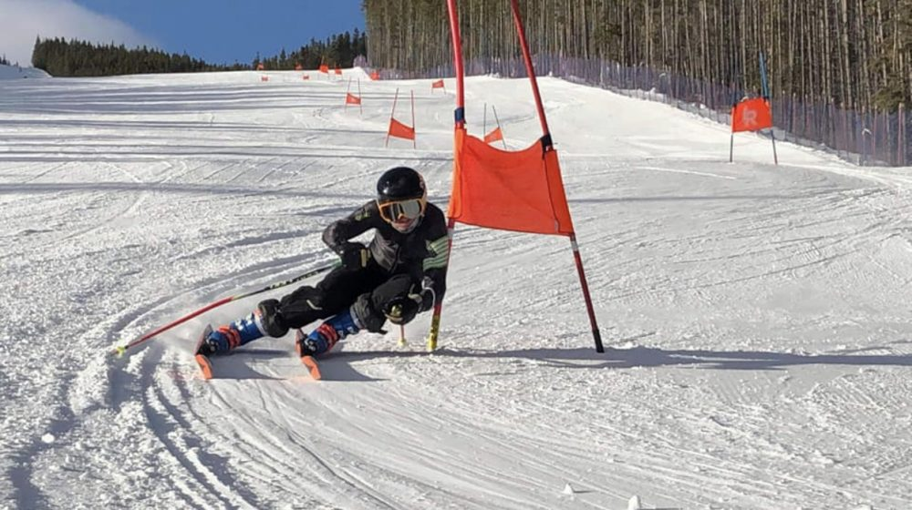 Student skiing in race
