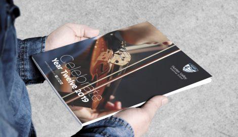 student holding magazine called Celebrate