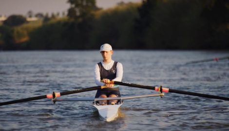 Student rowing on a river