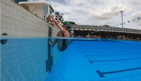 Student about to swim backstroke