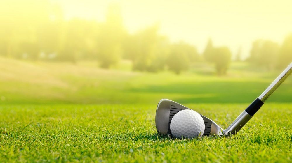 Image of golf club and golf ball