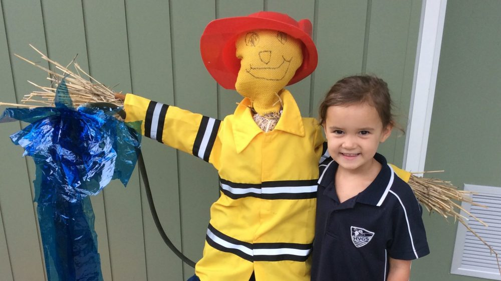 student with scarecrow