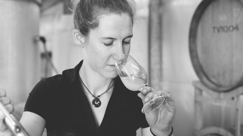 women smelling wine