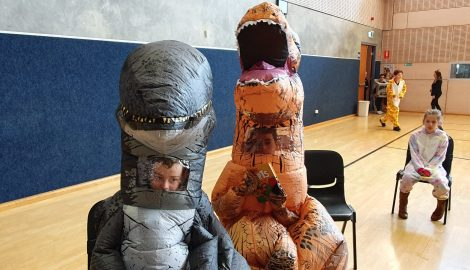 Two students dressed as dinosaurs