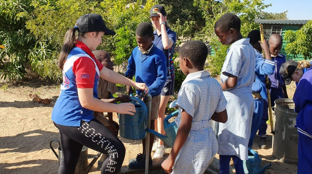 students pumping water in Africa