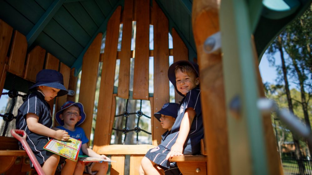 children playing in cubby house