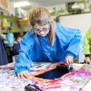 student doing art