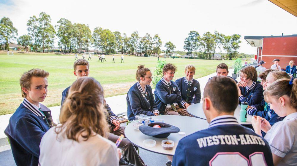 senior students meeting around table