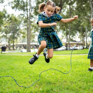 student jumping on rope