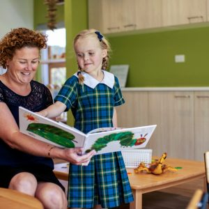 kindy student and teacher reading