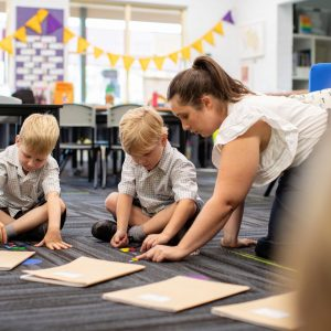 kindy students working in class
