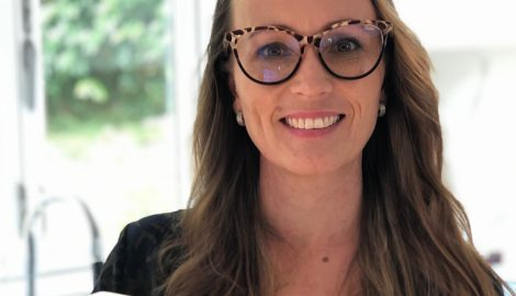 Woman smiling wearing glasses