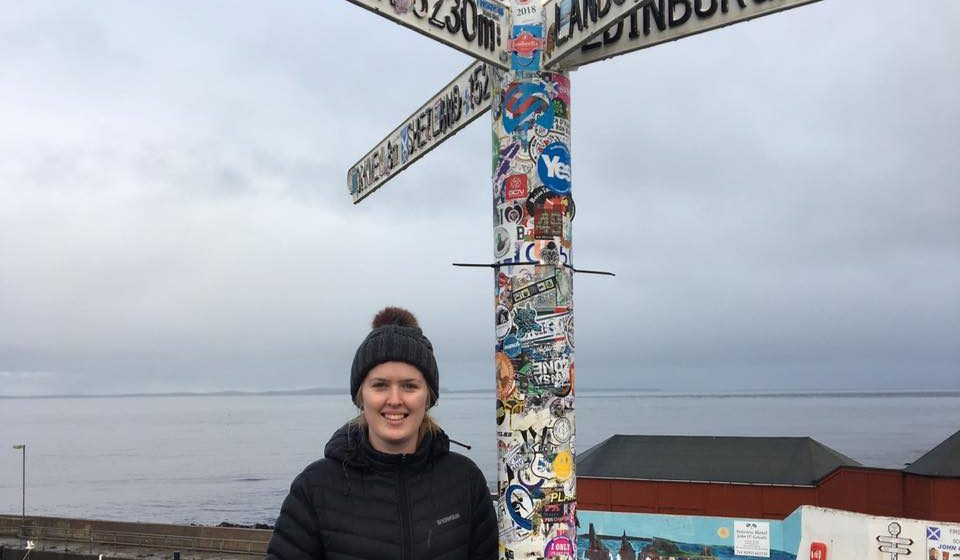 lady standing near a number of directional signs