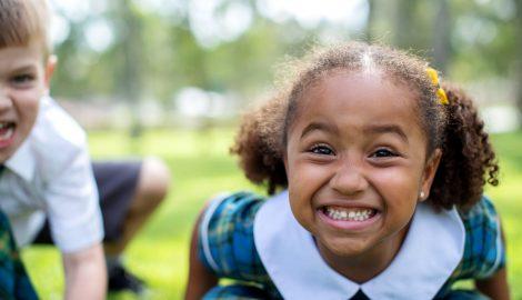 child grinning at camera