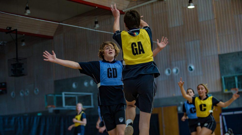 student playing netball