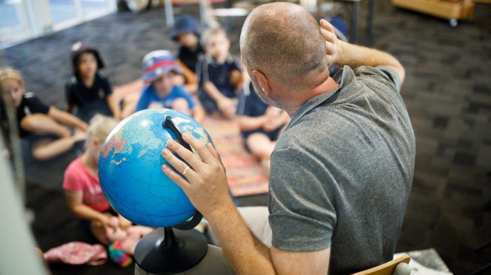 teacher with a globe