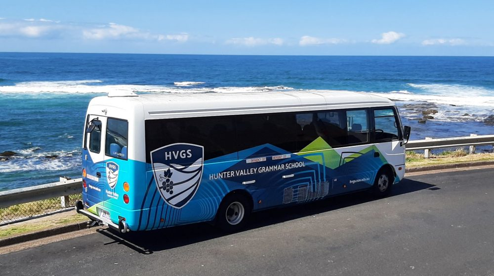 bus positioned by the ocean